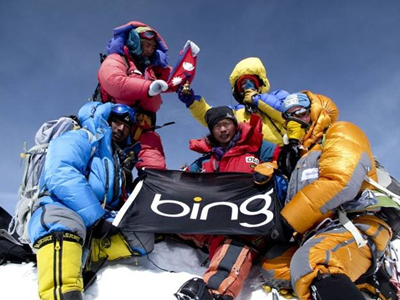 Eric Larsen and his team on top of Mt. Everest with the Bing Flag